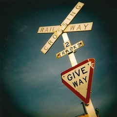 Give Way (sonofwalrus) Tags: blue red sky white film sign jack holga lomo lomography scan giveway queenscliff railwaycrossing 2tracks hpc5380