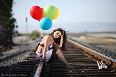 Katrina (Light Stalker) Tags: balloons katrina interestingness traintracks tracks naturallight 5d inexplore reflectivelight ef135mmf2lusm colorfulballoons