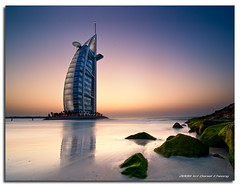 Burj on the Rocks! (DanielKHC) Tags: sunset sea green beach digital moss high nikon rocks long exposure dubai dynamic dusk uae burjalarab range dri hdr jumeirah blending d300 dynamicrangeincrease  aplusphoto danielcheong danielkhc tokina1116mmf28 gettyimagesmeandafrica1