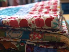 folded (joontoons) Tags: ikea quilt handmade sewing fabric quilting redandblue patchwork birthdaygift applique gardenparty alexanderhenry freemotionquilting ikeafabric annamariahorner sandihenderson joontoons