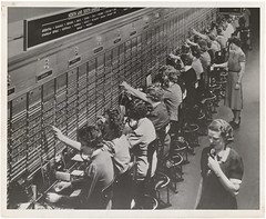 Photograph of Women Working at a Bell System Telephone Switchboard (The U.S. National Archives) Tags: bw workers women bell telephone worldwarii 1940s operators switchboard thewayweworked usnationalarchives womensbureau nara:arcid=1633445