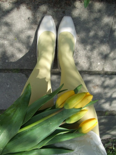 Yellow tulips and green tights