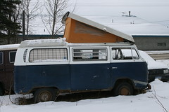 Blue Bay Window VW Bus Campmobile with extended roof up in Wasilla, Alaska - Passenger Side View