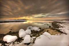 Snow Tide (mortenprom) Tags: ocean morning winter light sea sky orange sun snow black color reflection ice beach nature water yellow oslo norway stone clouds sunrise landscape island golden norge sand rocks tripod skandinavien norwegen wideangle explore shore noruega february scandinavia peninsula 2009 hdr goldenhour oslofjord huk noorwegen noreg wideangel sigma1020mm skandinavia nd1000 abigfave nd30 bw110 canoneos40d theunforgettablepictures nd1000x naturaldensityfilter mortenprom mortenrovik