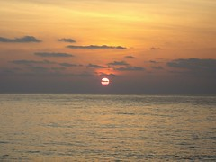 Red sun (Dave DiCello) Tags: ocean trip morning red vacation orange sun beach gulfofmexico water yellow clouds sunrise point mexico early sand surf shoot waves pentax 7 casio shore dreams cancun caribbean optio s7 mexicovacation cancunvacation dreamvacation cancunmexico dreamscancun sunriseocean dreamsresortandspa dreamspalmbeach beachorseaoroceanorsandorclouds abeachinthemorning imagesunoverwater evad310 dreamsresortinmexico davedicello