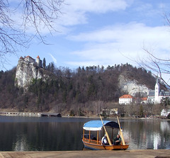 Bled Castle and Pletna boat, Slovenia (mirci) Tags: lake alps castle europe eu slovenia bled 2009 julianalps gorenjska bledcastle bledlake pletna mirci mirjanapapez