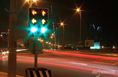 Trafic light Red , Yellow and Green ( EXPLoRED) (AlAmmari) Tags: world light red green cars love yellow night canon lights moving bahrain you go center explore stop u wtc trade juffair  manama trafic muharraq beutiful guage   streem alammari         hourbour  d450     finicial     fotocompetitionbronze lightstreem