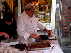 Man making chocolate on the street (Andrew and Kerry) Tags: belgium bruge