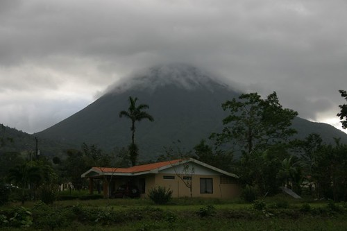 Volcán Arenal under the clouds.