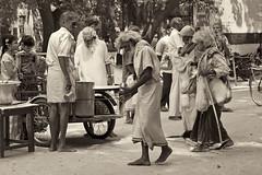 Sanyasis Receiving Lunch (debra booth) Tags: india sepia hindu tamilnadu ashram copyrighted ramana maharshi thiruvannamalai arunachala sannyasin sanyasin sanyasi sannyasi debrabooth sriramanamaharshiashram sannyasa