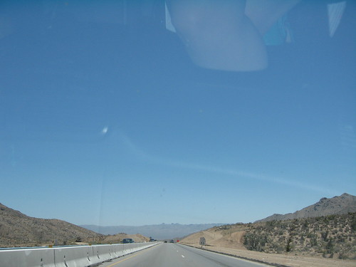 Nothing like a road trip to accustom you to views of the road, the sky, and sundry parts of your body reflected in glass.