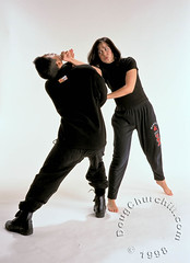 Shannon Lee • 29 November 1998 (Doug Churchill) Tags: california people usa motion celebrity sport female standing training portraits movie studio energy action daughter martialarts karate whitebackground shannon lee agility prominentpersons strike punching leisure effort strength punch activity aggression striking twopeople defense challenge brucelee oneperson active flexibility skill vitality shannonlee exercising americancelebrity celebrityasbasicelement celebrityposture sportsclothing healthylifestyle recreationalpursuit