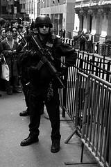 welcome to new york (nikonman3) Tags: new york street d70 nyc city nikon usa urbanlandscape urban portrait photography people ny newyorkcityd70s newyorkcity newyork metro man grit gotham bw blackwhite blackandwhite american america 1870 cop police officer swat m16 gun