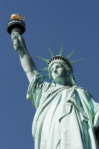 The Statue of Liberty serves as a beacon of hope in New York. Image courtesy of jver64