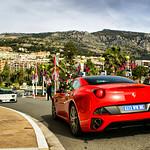 Ferrari California and Lamborghini parked in front of Hotel the Paris