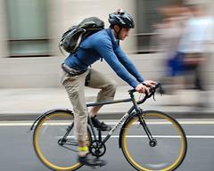 Kona Paddy Wagon (jeremyhughes) Tags: street city motion london yellow speed cycling movement nikon cyclist zoom steel helmet backpack commuter singlespeed nikkor rucksack panning kona vr fenders knapsack paddywagon d40 mudguards nikond40 raceblades yellowwheelrims