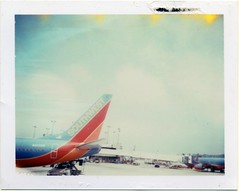 Vintage Southwest Air - circa 2009 (daveotuttle) Tags: southwest window tarmac vintage polaroid airport sandiego air airline expired circa packfilm 669film peelapart southwestcom southwestair supercolorpack swair