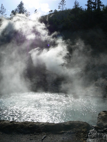 Steam coming off hot pool in Yellowstone park wyoming