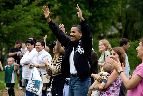 President Barack Obama cheers for his daughter Sasha's soccer team at a park in Washington, D.C. on May 16, 2009