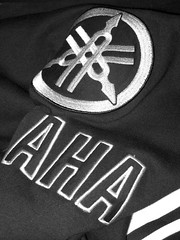 Aha, it's a Yam.... (davekpcv) Tags: white black logo graphics embroidery jacket yamaha lettering forks tuning brand aha yamahatuningforks