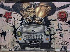 Berlin Wall Art Trabant (Vlastula) Tags: street west berlin art car wall germany concrete deutschland graffiti mural gate kiss kissing gallery panel symbol flag union prefab east licenseplate communist german sovi