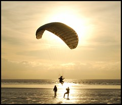 Fun on the beach (Levels Nature) Tags: sunset sea sun beach silhouette golden photo amazing sand glow group somerset paragliding burnham the brean saariysqualitypictures bestofmywinners