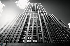 Empire State Building (Jrg Dickmann Photography) Tags: city nyc newyorkcity urban bw sunlight ny newyork building topf25 architecture skyscraper blackwhite unitedstates manhattan explore esb sw empirestatebuilding empirestate canon5d 24mm canon2470 flickrunitedwinner