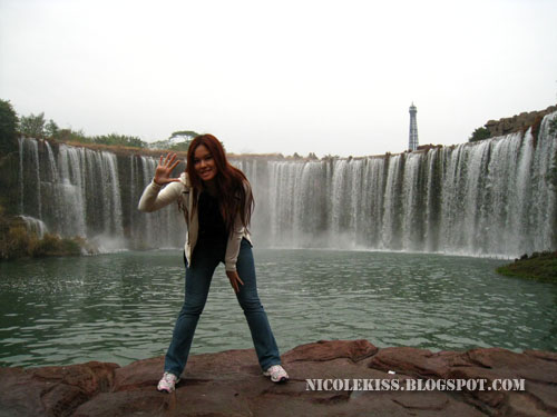 standing in front of mini niagara fall