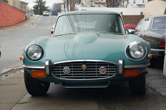 Old Jaguar E-type sports car: front view (close)