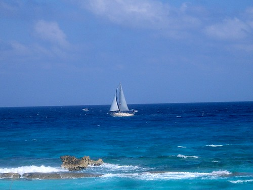 ocean blue water clouds sailboat mexico sand cancun seashore anawesomeshot