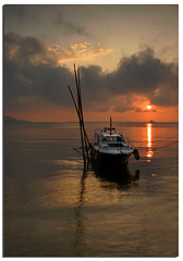 We can only appreciate the miracle of a sunrise if we have waited in the darkness (Nora Carol) Tags: ocean morning sea sun seascape reflection sunrise boat earlymorning calm serenity malaysia borneo l sabah sandakan malaysianphotographer sulusea flickrdiamond noracarol sonya200 sabahanphotographer landscapephotographerfromsabah womanlandscapephotographer womaninphotography