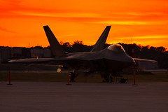 Sunset on the F22 Air Forces newest Fighter (RMac_Photography) Tags: atlanta sunset orange silhouette speed plane ga wow d50 georgia airplane cool nikon fighter shadows atl aircraft military jet fast aeroplane installation f22 airforce base rmac dobbins