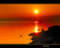 OVEST.. (sirVictor59) Tags: sunset red italy orange lake sol nature water beautiful silhouette yellow lumix topf50 nikon bravo europe italia tramonto nikond70 ombra natura panasonic sole 1001nights 70300mm topf150 topf100 rosso soe viterbo vulcano controluce bolsena italians lazio lagodibolsena rossodisera controluz aplusphoto colourartaward platinumheartaward sirvictor59 saariysqualitypictures