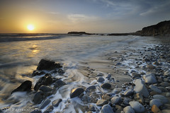 Pescadero State Beach Sunset (Jim Patterson Photography) Tags: ocean california longexposure sunset sea sky sun seascape beach water clouds landscape evening coast sand rocks waves pacific stones shoreline rocky cobble highway1 coastal shore foam coastline ripples pescadero pacificcoasthighway statebeach nikkor1224mm nikond300 beneathblueseas beneathblueseascom jimpattersonphotography jimpattersonphotographycom goldenblog2010 seatosummitworkshops seatosummitworkshopscom