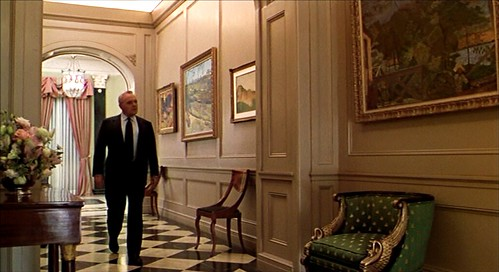 MeetJoeBlack_hallway_greengoldchair