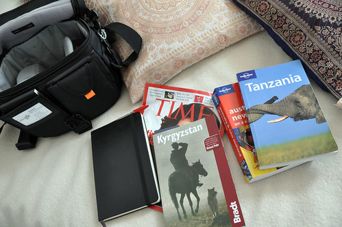 travel guides, camera bag, moleskine..