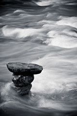 Rocky Mountain River - 1 (Darby Sawchuk) Tags: longexposure blackandwhite canada water river rocks stones motionblur alberta rockymountains banffnationalpark