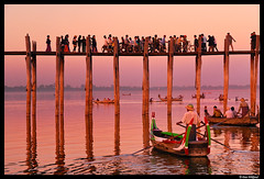 Burma: Amarapura dreams (Dan Wiklund) Tags: wood bridge sunset people lake reflection water boats evening wooden southeastasia footbridge burma myanmar d200 2010 amarapura ubeinbridge ubein doublyniceshot amarapua lpserenity