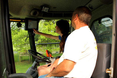 Jim and Jenna in the cab of the new combine.