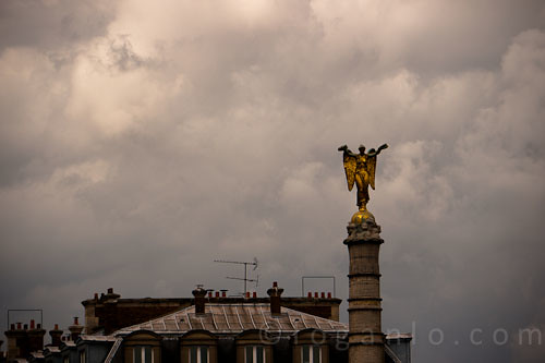 Statue against a cloudy Paris sky in France