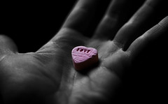 Take the pill, live happily ever after (Crazy Ivory) Tags: camera pink light shadow blackandwhite bw black color love public colors canon wonderful 50mm amazing hand fav50 traces fav20 f18 fav30 schatten pill selectivecolor fav10 fav100 fav40 fav60 fav110 fav90 400d fav80 canoneos400d fav70 fav120 gettygermanyq2 gettygermanyq3 gettygermanyq4