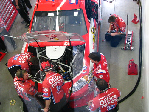 Team OfficeDepot/OldSpice Guys work on the the number 14 Impala