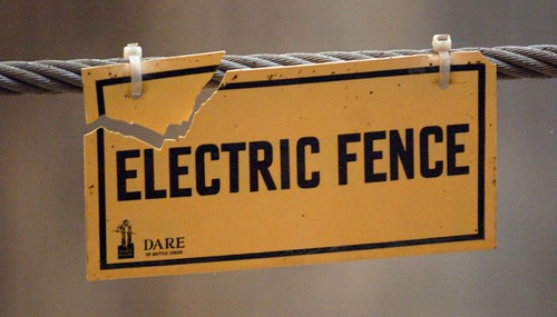 An electric fence sign in the pachyderm building of the Columbus Zoo.