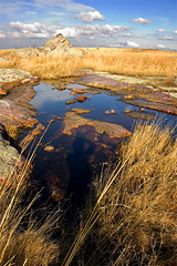 Eagle Rock (photo.klick) Tags: park shadow reflection water grass minnesota clouds photoblog prairie mn quartzite jol luverne dnr bluemoundsstatepark katsingercom