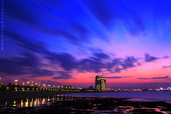 Baby Colors Sunset (A.alFoudry) Tags: city nightphotography pink blue winter light sunset sea sky motion reflection building beach water colors night canon stars landscape eos lights moving high movement slow gulf babe full shore silence frame slowshutter shutter land third 5d nightshots nightphoto kuwait usm arabian fullframe scape effect ef 1740mm canonef1740mmf4lusm 1740 pinkish kuwaitcity kuwaiti arabiangulf thirds slowmotion q8 babyblue abdullah   canon1740 f4l babypink canoneos5d  kuw q80 q8city babeblue xnuzha alfoudry  abdullahalfoudry kuwaitbeach foudryphotocom babepink