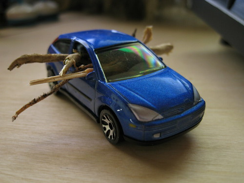 toy '00 Ford Focus hatchback with tiny logs