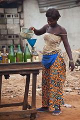 Woman at gaz station. Portrait, Cotonou, Bnin, Africa. (E. B. Sylvester) Tags: africa portrait woman station gaz fill afrique cotonou bnin ebsylvester
