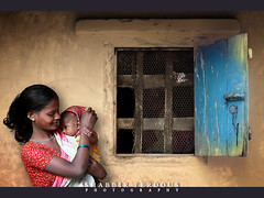 Celebrating Womanhood (Shabbir Ferdous) Tags: blue portrait woman baby color colour window wall photographer shot mud bangladesh bangladeshi womanhood srimangal youngmother ef70200mmf28lisusm canoneos5dmarkii shabbirferdous wwwshabbirferdouscom shabbirferdouscom