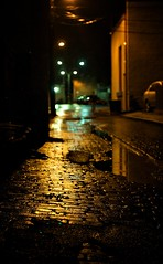 (m. wriston) Tags: city light urban orange usa reflection night 35mm lens puddle prime lights alley nikon focus streetlight glow dof maryland baltimore cobblestone handheld f2 manual nikkor hampden available preai d40 35mmf2ai