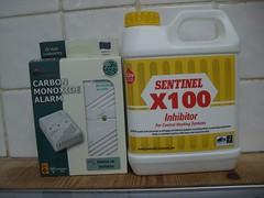 Alarm and central heating inhibitor